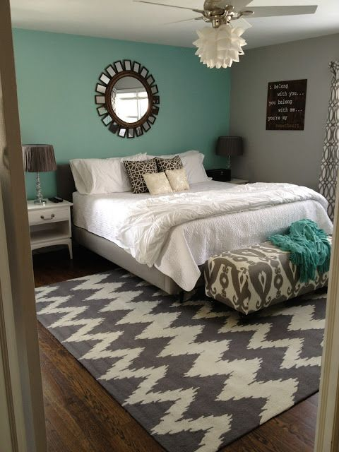 grey and teal bedroom - Love the rug and also, didn't know you could put a light fixture on a fan, but good to know b/c you NEED fans in South Texas!