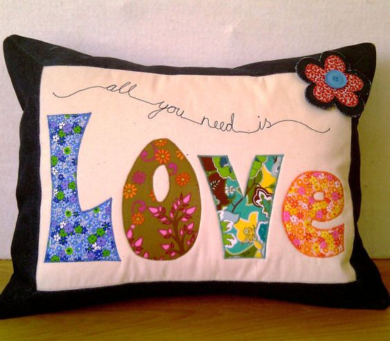 go to etsy - type in 'applique cushion' and there's loads of inspiration.......
