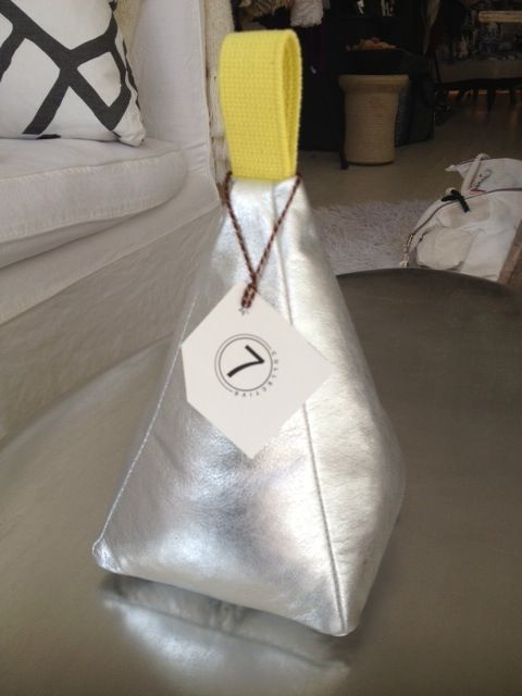 Metallic silver doorstop by 7 Collection,  $130. Available through 7 on Locust.