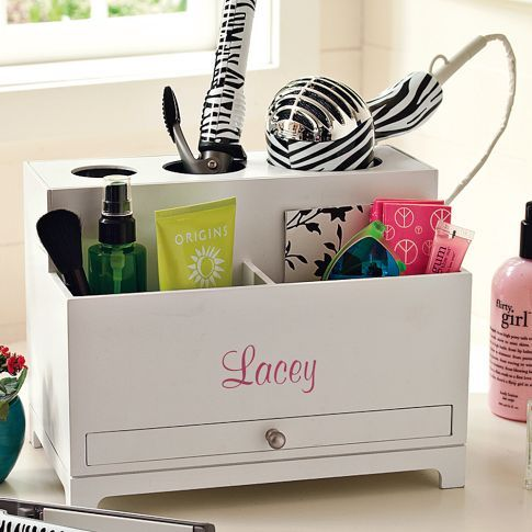 This Smart Technology™ product is designed with a built-in outlet so you can plug in and recharge electronics.      Finally – a place to keep all your get-ready supplies organized. This compact unit has slots on top for your hair dryer, flat iron, and curling iron, plus a drawer below for clips, accessories and more.