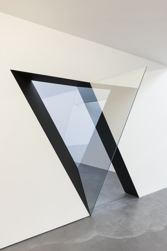 Sarah Oppenheimer is challenging the distinction between art and architecture with a unique collection of windows and wall openings. Using wall incisions and glass as her mediums, Oppenheimer blurs the line between room and painting. From 2012 to present, Oppenheimer's work has been featured in the PPOW Gallery in New York City, as well as in Kunsthaus Baselland and Von Bartha Garage in Switzerland.