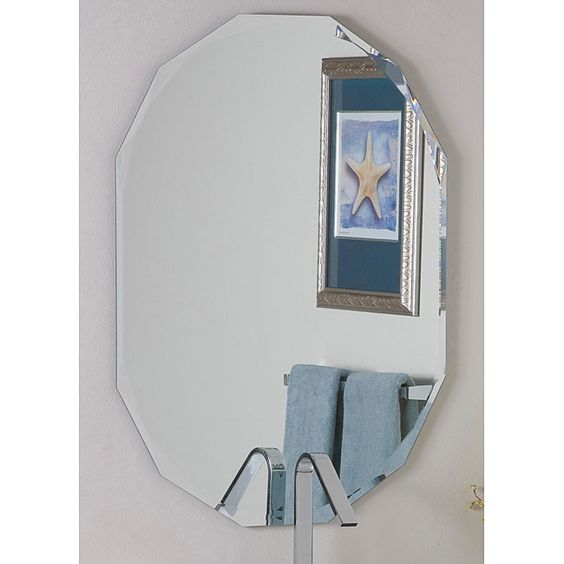 This frameless diamond wall mirror adds sophistication and style to any home. This durable mirror is made with two thick layers of metal and glass and features an artistic double bevel angle. This mirror will look wonderful in any room of the house!