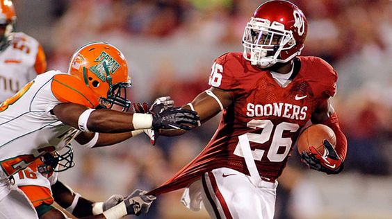 Sooners 69- Florida AM 13.   I like this picture, of the one player grabbing the jersey from behind and the other trying to tackle him.