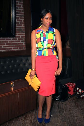 multi-colored vintage top with a red skirt, a yellow H clutch and blue Louis Vuitton pumps.