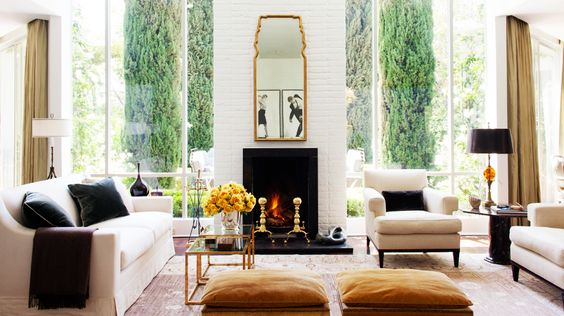Sofas 101: The Ultimate Guide to Shopping for a Sofa // white living room, gold mirror, fireplace
