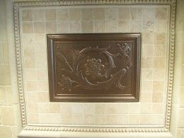 Metal tile accents have been for a long time been used for decorative function of kitchen backsplashes.