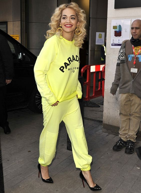 Rita Ora arrives at the BBC Radio 1 studios wearing a fluorescent yellow tracksuit, accompanied by black stiletto shoes in London, England, on February 15, 2013