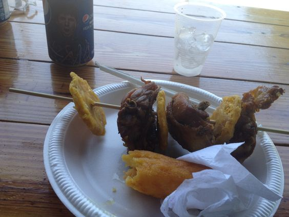 Chicken and tostones on a stick and fried cheese