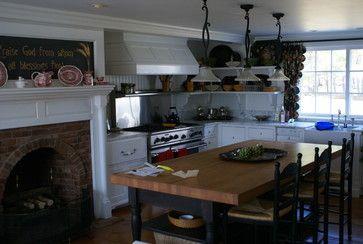 dark island w/ butcher block and white cabinets