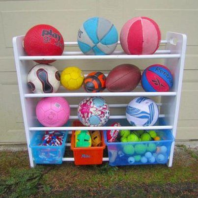 ball storage using a kids storage rack! Skipping ropes, etc in the bottom buckets. I needed this years ago!
