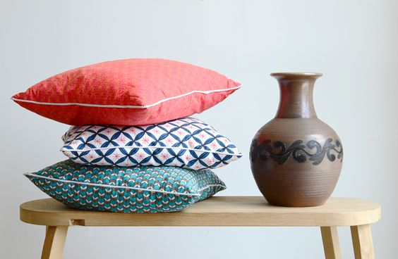 nala pillows next to mothers old vase on our tom dixon bench.