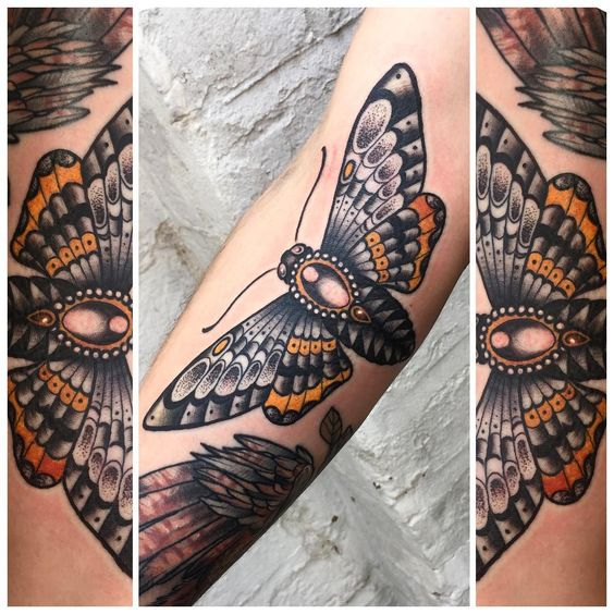 Neo traditional moth tattoo.