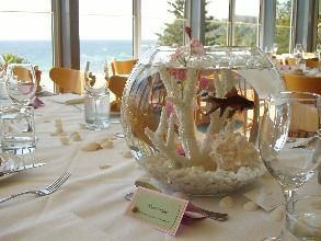 Beach theme reception hey Ray it's like the goldfish favor story I told you haha but with beta fish!