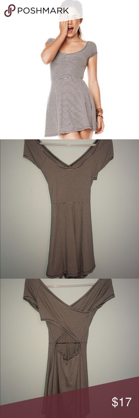 Brandy Melville Striped Dress Brandy Melville striped black and white skater dress, worn a few times but still in very good condition! Skater style dress with a cut-out in the back, very flattering. Brandy Melville Dresses Mini
