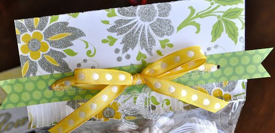 such a cute way to give a note with a treat in a bag! Scrapbook paper and ribbon