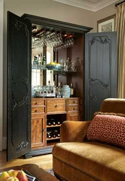 The Madeira Beverage Cabinet is an elegant addition to any home. Armoire styling and decorative wooden scrollwork open to reveal a full bar cabinet complete with ample space for barware storage.