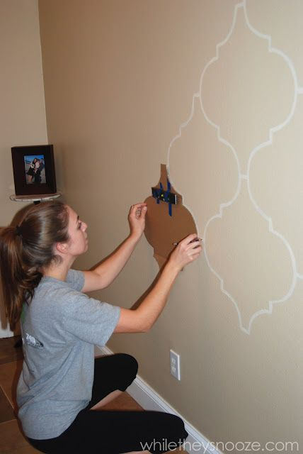 DIY Moroccan-Style Wall Stencil Tutorial - tape a level to your stencil to get a perfectly straight pattern