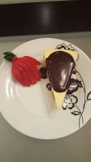Homemade mascarpone cheesecake with almond graham crust and hazelnut chocolate topping.