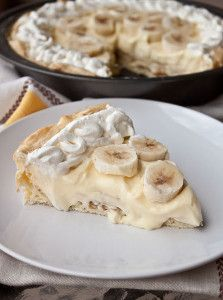 Heavenly Banana Cream Eclair Pie - This pie is served cool, so it's perfect for summer. A light and fluffy eclair crust is filled with a creamy banana pudding and fresh bananas in this easy dessert recipe.