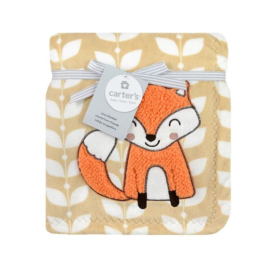 "Your little one deserves something soft and warm; this cozy velour blanket from Carter's is just the thing. The solid beige background features printed leaves with an adorable orange fox applique. This blanket is crafted using silky smooth 100% polyester, measures 30"" x 40"", and is machine washable. Tumble dry low."