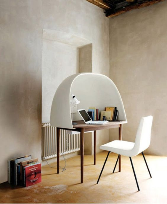 Ligne Roset's Rewrite desk by designers GamFratesi.  The desk has a cave-like shield on top to create a private working environment. This fiberglass cocoon is covered in foam and woolen fabric, while the desk itself is made of walnut. A slit in the back of the surface accommodates cables while a lacquered steel container underneath hides laptop transformers and loose wires. #LigneRosetSF #LiveBeautifully #Office #Home www.lignerosetsf.com