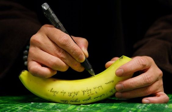 Brother Phap Huy writes a get well note on a banana for a sister who was ill and could not attend lunch at Magnolia Grove Monastery. A care package was sent to her to make her feel better. All the meals that are prepared by the monks and nuns and are vegan. (Alan Spearman/The Commercial Appeal)    I am here for you.  - Tich Nhat Hanah: Sister, Banana, Care Package, Photo