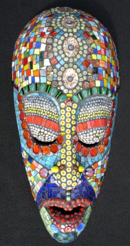 I have a huge collection of African masks - and some could use a makeover...