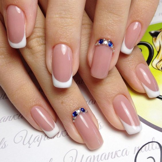 A gentle classic french never fails. Narrow long nails look even more elegant thanks for the visually lengthen the nail plate by coated base. The zest of t