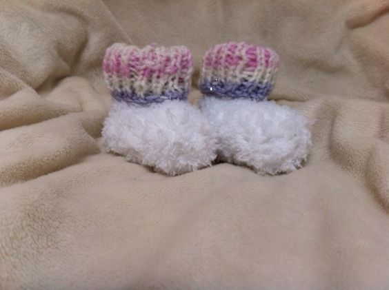 These super soft and easy to knit booties are Bernat's ...