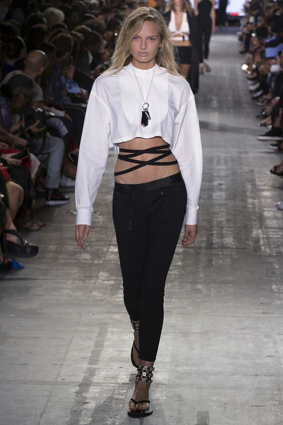 """Alexander Wang Spring 2017 RTW: Easily a look that I'd copy: White crop-top sweater, black pants, black bandage """"top"""" under the sweater (although I'd throw pumps with it instead of this particular style of shoe)."""