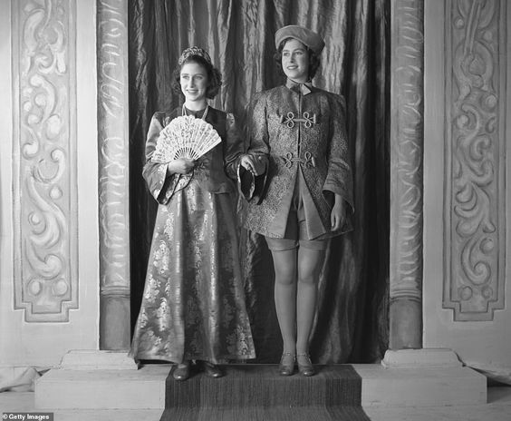 The four royal pantos were staged during the war after the future Queen and her younger sister were evacuated from Buckingham Palace at the conflict (pictured Elizabeth and Margaret during Aladdin in 1943). The pair stayed at the Royal Lodge, in Windsor, until 1945. Their parents King George VI and Queen Elizabeth stayed in London during the week and returned to them at weekends.The idea to stage a panto came after the two young princesses appeared in a concert with children from the Royal Scho