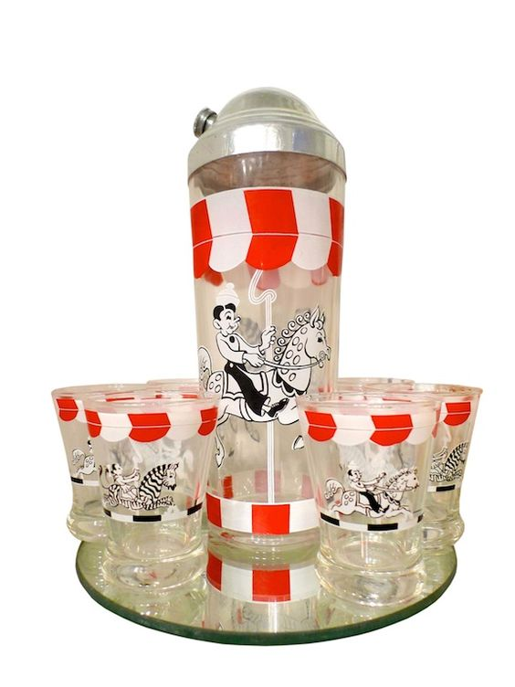 American Mid-Century carousel design cocktail set. Comprising of a shaker and 6 glasses. Offered by Robinson's Antiques.