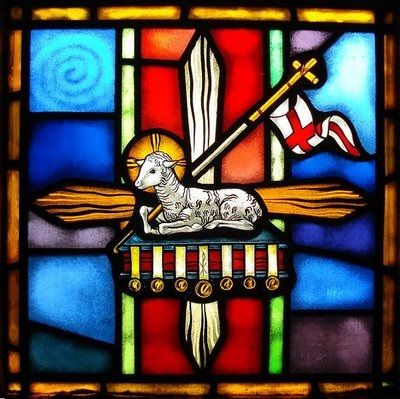 "the lamb represents Jesus, ""the Lamb of God"" (Agnus Dei)  Seated on a book with the 7 seals in Revelation, the lamb represents the judgment of Christ - the final judgment when He comes in glory."