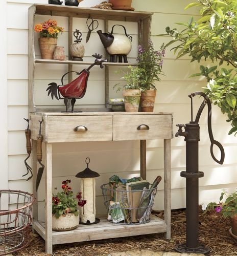 love the potting bench and the flower pots :)