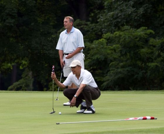 President lining up a putt on Hole #1
