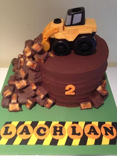consturction party digger birthday cake. white chocolate mud layered with whipped milk choc ganache surrounded with violet crumble and crunchie bars.  Available from  Frenchs Forest, NSW, Australia - Koo and Cupcakes