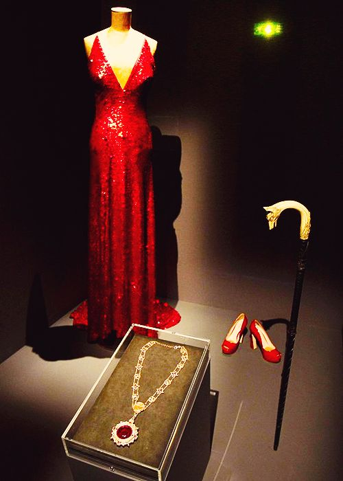 """Angelique's Dress and Shoes, worn by Eva Green in Dark Shadows, 2012, and Barnabas Collin's Medallion, worn by Johnny Depp, are displayed during the event """"Tim Burton, the Exhibition"""" at the Cinematheque Francaise in Paris."""