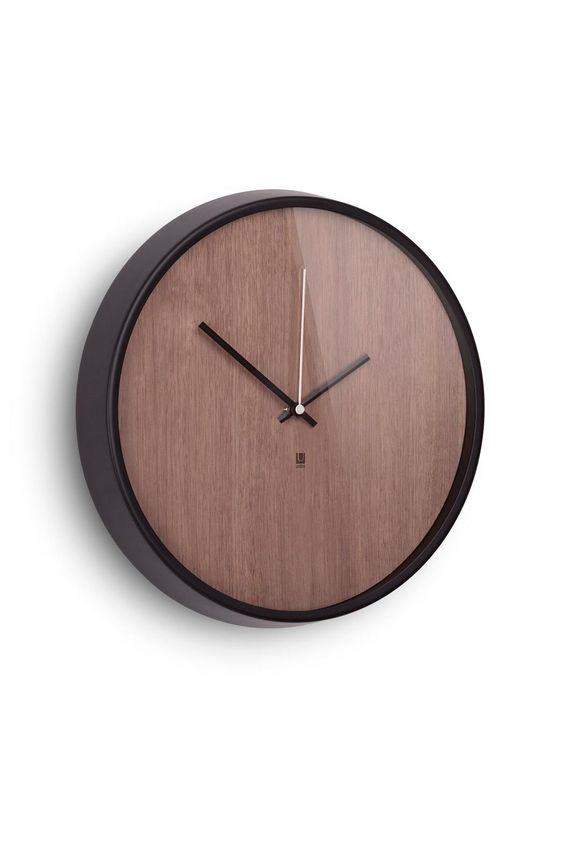 "This tasteful timepiece has the style of a classic, numberless analog wristwatch, with a modern touch: an Ashwood veneer face with a walnut stain and an aluminum rim. Measures 12.75"". x 1.5"".   Madera Wall Clock by Umbra. Home & Gifts - Home Decor - Wall Art Washington"