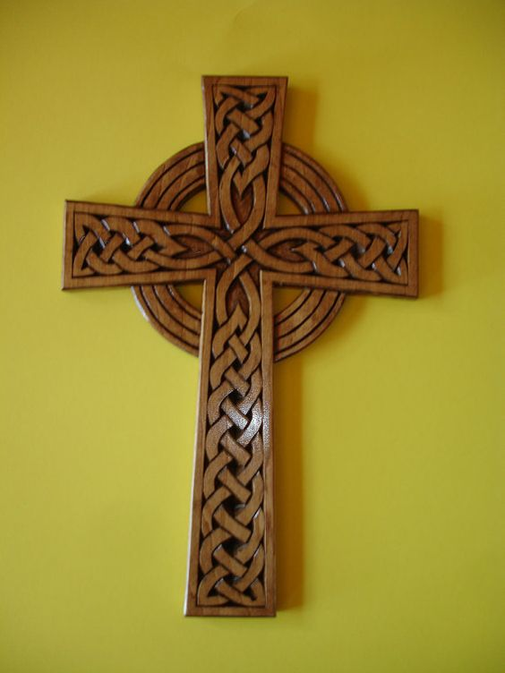 Celtic sun cross made of wood by hand carving hands