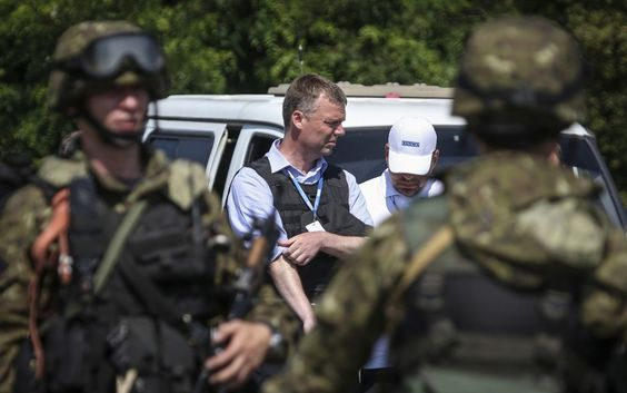 This photo shows OSCE being stopped by pro Separatist troops in the Ukraine.