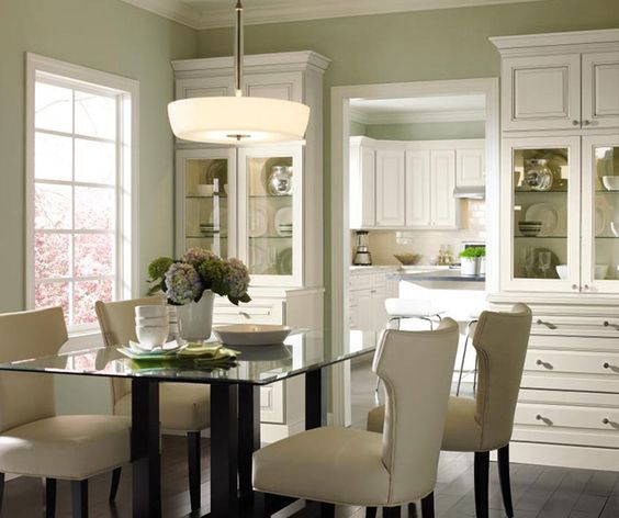 (Painted Maple by Homecrest) Select dining room cabinets that match your kitchen, then easily configure them to create a custom furniture look, with areas to display those favorite pieces that only get used on holidays. Table linens will always be handy while glass doors and in-cabinet lighting let your crystal be seen while adding depth to the room.