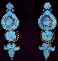 Turquoise and gold earrings worn by the women of Lhasan high society. Tibetan Civilisation.