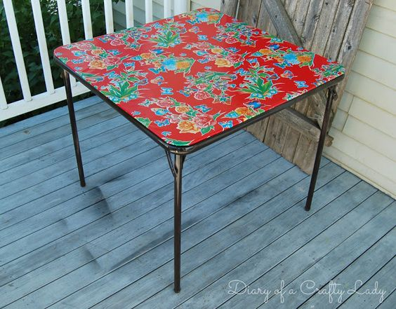 Revamped card table using new vinyl from the fabric store.