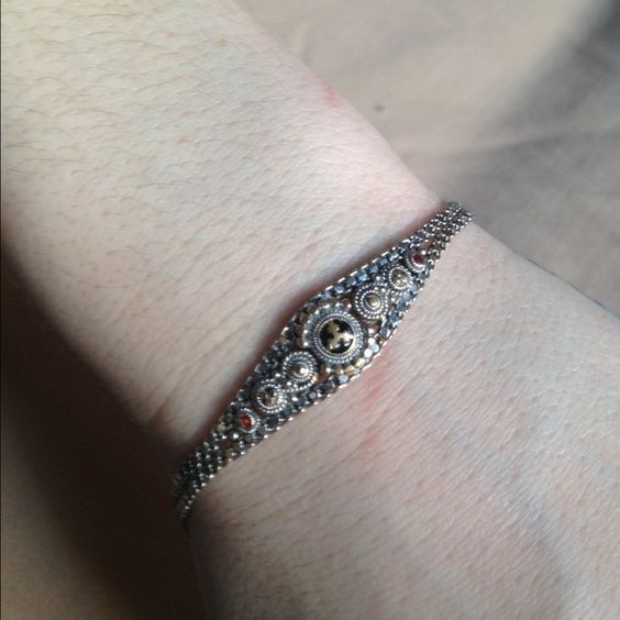 Two sided bracelet from India This is absolutely beautiful and can be worn either side one side has black and red in it and the other looks gold and silver im not too sure it does have markings but can't make them out Jewelry Bracelets