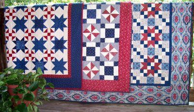 Three of my R-W-B quilts on the deck