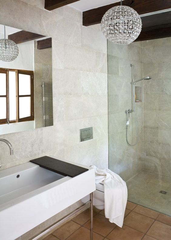 Love the light fixture and LOVE the super-modern sink