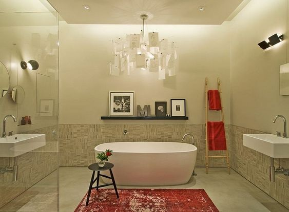 Mercer Street Loft by DHD NYC featured on Casa y Diseno - bathroom with white bathtub interesting lamp by Ingo Maurer