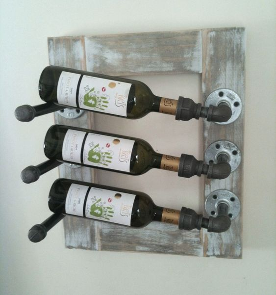 I love the industrial look of this wine rack! Very cool idea!: