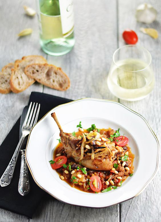Catalan Rabbit With Onion (Conill Amb Ceba) - LexiBites.com - Rabbit braised in tomatoes and onions with pine nuts, raisins and brandy or whiskey. Gluten-free. #Catalan #Spanish: