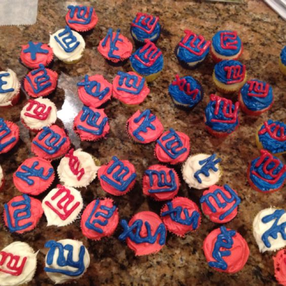 My super bowl cuppies!  Vanilla and Guinness cupcakes with buttercream icing and chocolate logos.